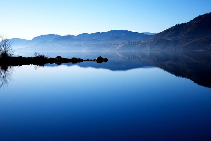 A still morning on Skaha lake at the south end of Penticton | Credit: Darren Kirby CC BY-SA 2.0 Wikimedia | Penticton, BC